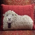 Sheep Against Barn Pillow  product image